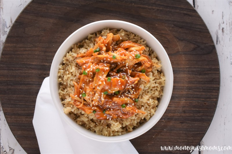 a close up of the bowl full of finished chicken teriyaki in the crockpot with rice.