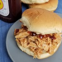 Featured image showing the finished slow cooker bbq chicken.
