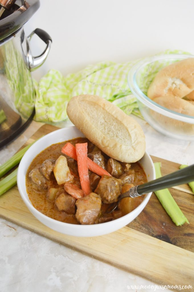 Finished slow cooker beef stew with bread.