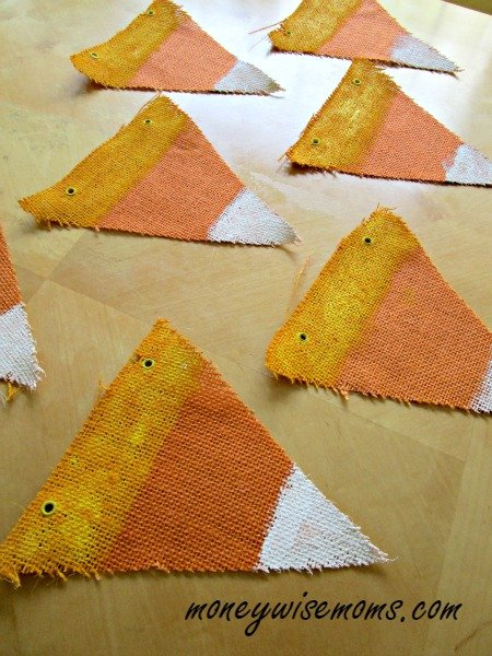 This Candy Corn Burlap Banner is easy to make for less than $5. Reuse it every year as Halloween decor!