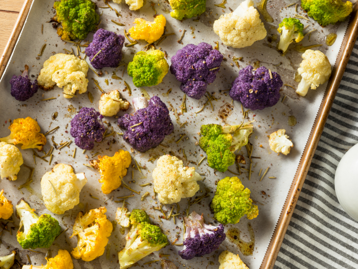 This easy Roasted Broccoli and Cauliflower recipe is a great way to serve vegetables with a crunchy, flavorful texture that kids love!