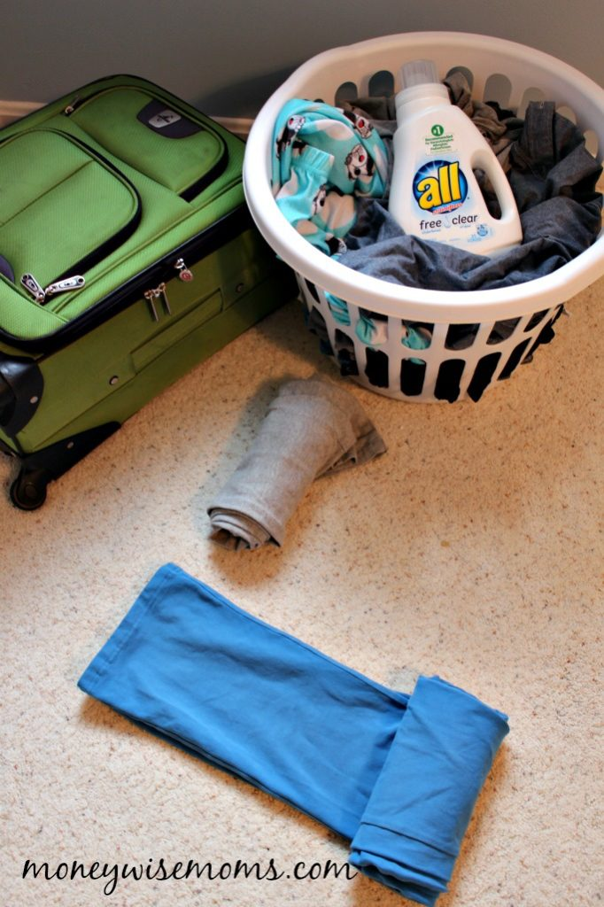 Rolling clothes to fit more - Teaching Kids to Pack for Family Travel