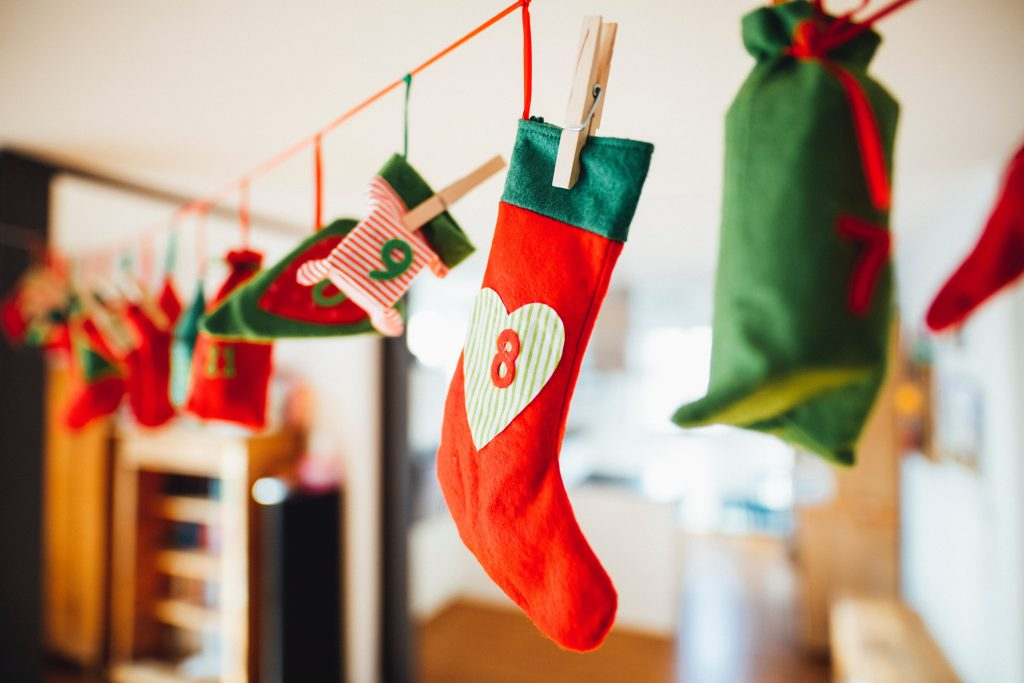 Red and green stockings hanging from ribbon