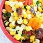 Looking for a new way to serve up some vegetable side dishes? This delicious corn salad with bacon is quick, easy, and delicious. The whole family will love this easy vegetable salad. It's a great picnic recipe as well.