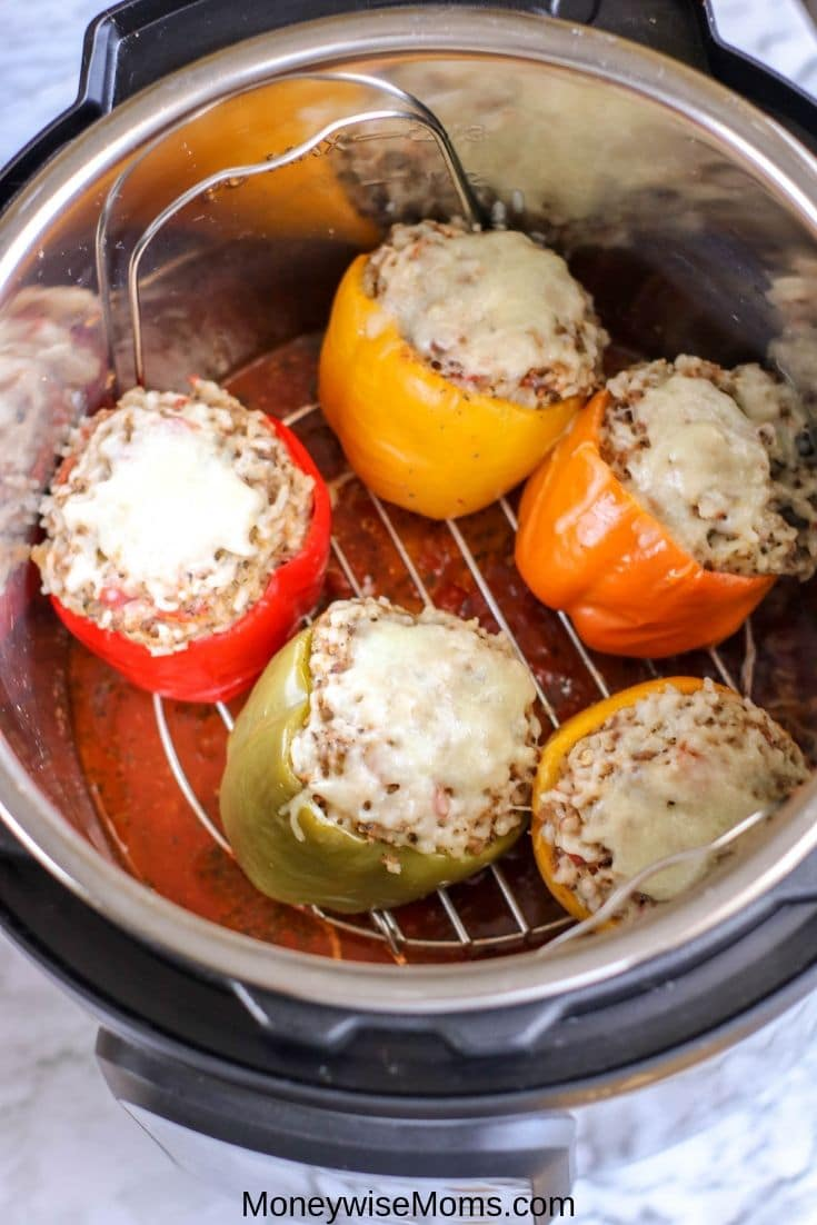 Making stuffed peppers for dinner is a breeze thanks to the pressure cooker! You can make these Instant Pot stuffed peppers for the whole family to enjoy with very little prep or planning! This is an easy dinner recipe that is delicious, customizable, and quick!