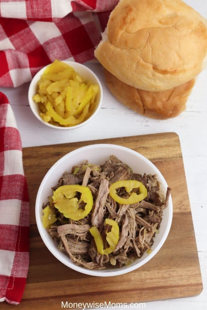 Italian beef with banana peppers in a white bowl