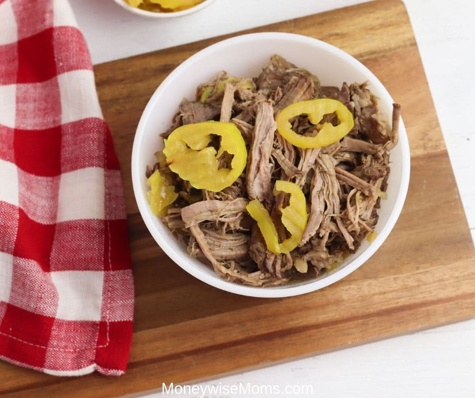 This Italian beef recipe is so easy and delicious. Now that we're back to school we need dinner recipes that require zero fuss! Crockpot dinner recipes are always a winner in my book. Everything goes in and dinner comes out. Not to mention the leftovers are great for lunches in sandwiches or wraps.