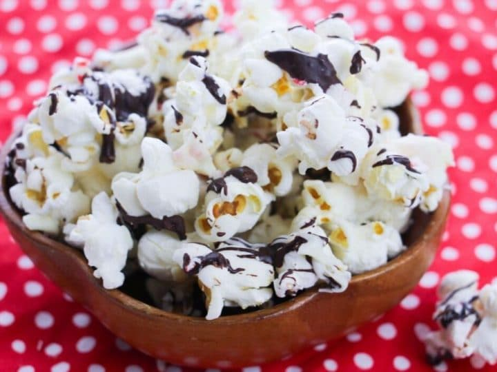 Making peppermint popcorn bark is quick and easy. It's a family favorite holiday recipe and makes a great gift for teachers, friends, and neighbors. Chocolate covered popcorn is a great sweet treat that you can make anytime!