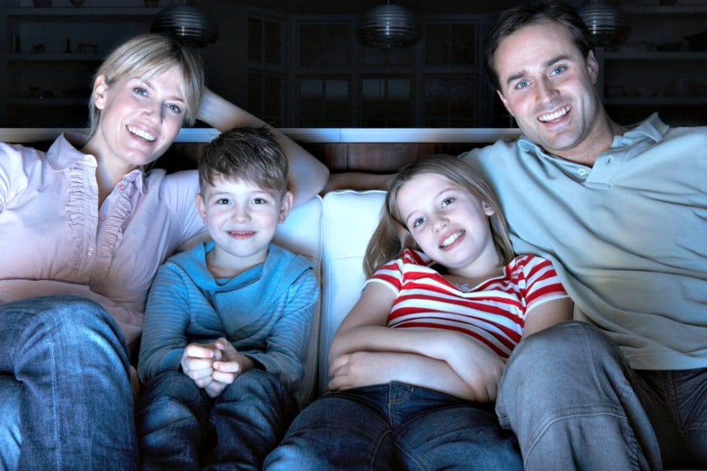 Family watching a movie for family movie night