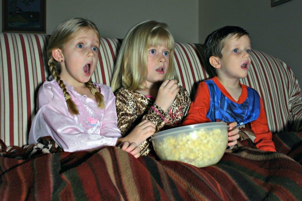 Kids watching a movie - family movie night ideas