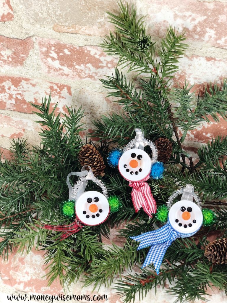 Three finished snowmen ready to be gifted or used for decor!