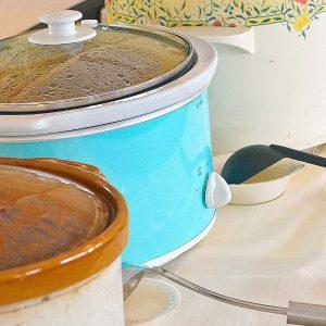 three crock pots on table