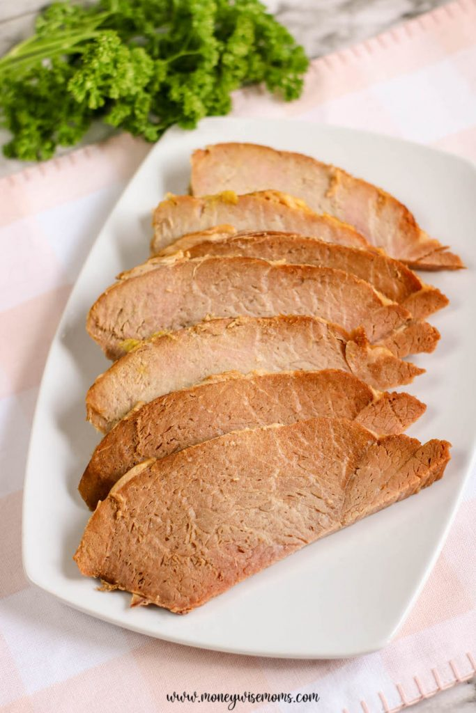 A plate full of the sliced ham ready to be enjoyed.