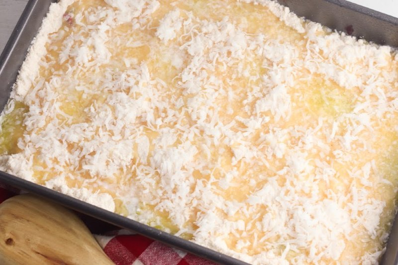 Coconut sprinkled on top of dump cake