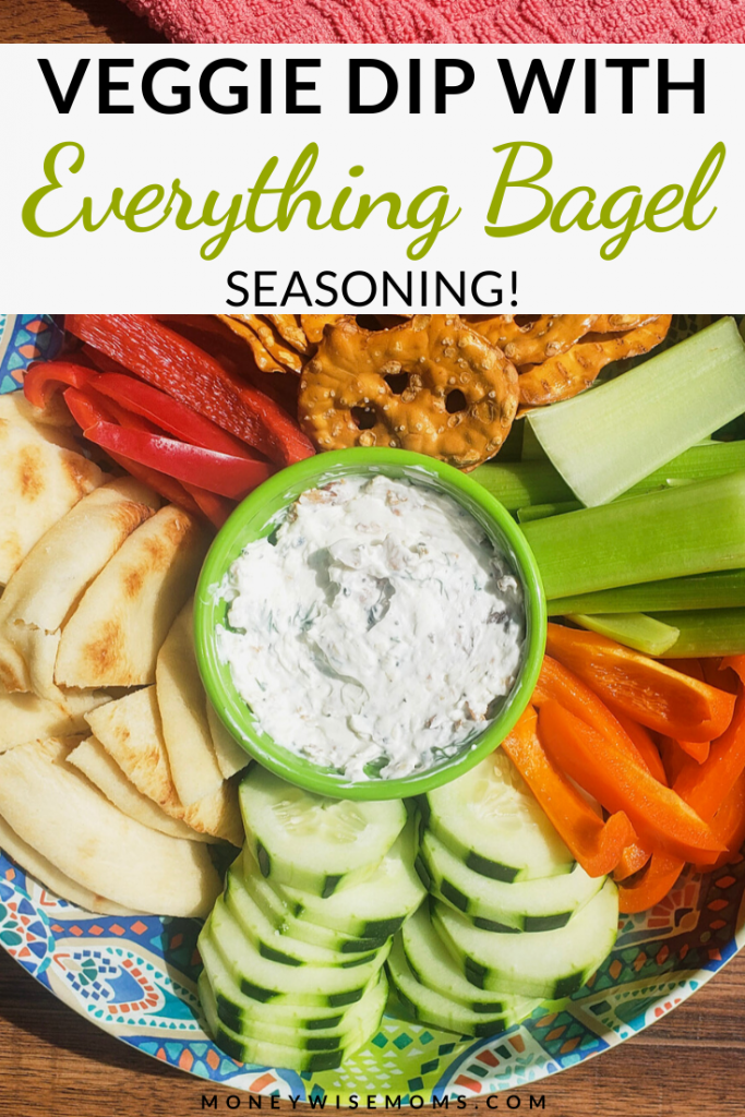 A pin showing the finished everything bagel seasoning dip with veggies and chips.