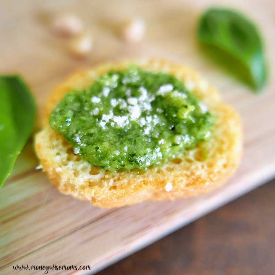 A look at the finished homemade basil pesto on a cracker ready to be enjoyed.