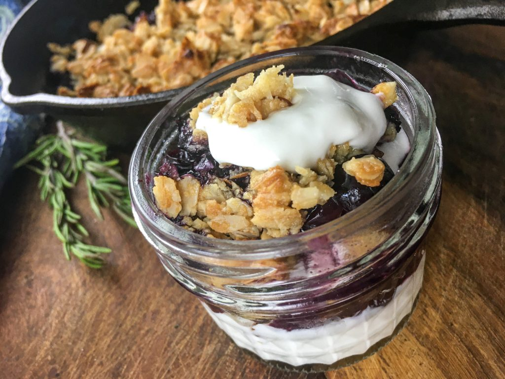 A close up view of the finished blueberry crisp ready to serve.