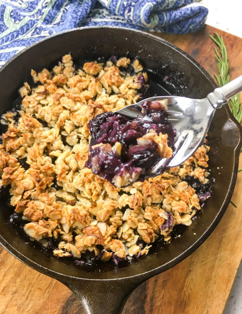 A top down look at the finished pan of blueberry crisp.