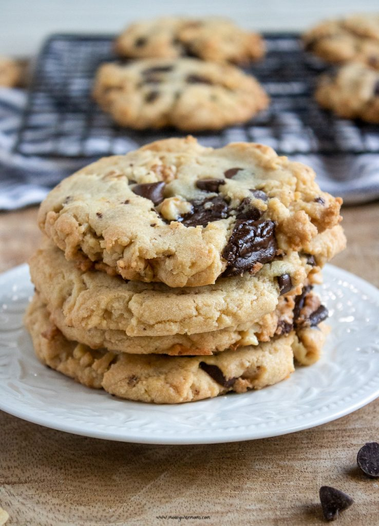 A stack of the finished chocolate chip walnut cookies.