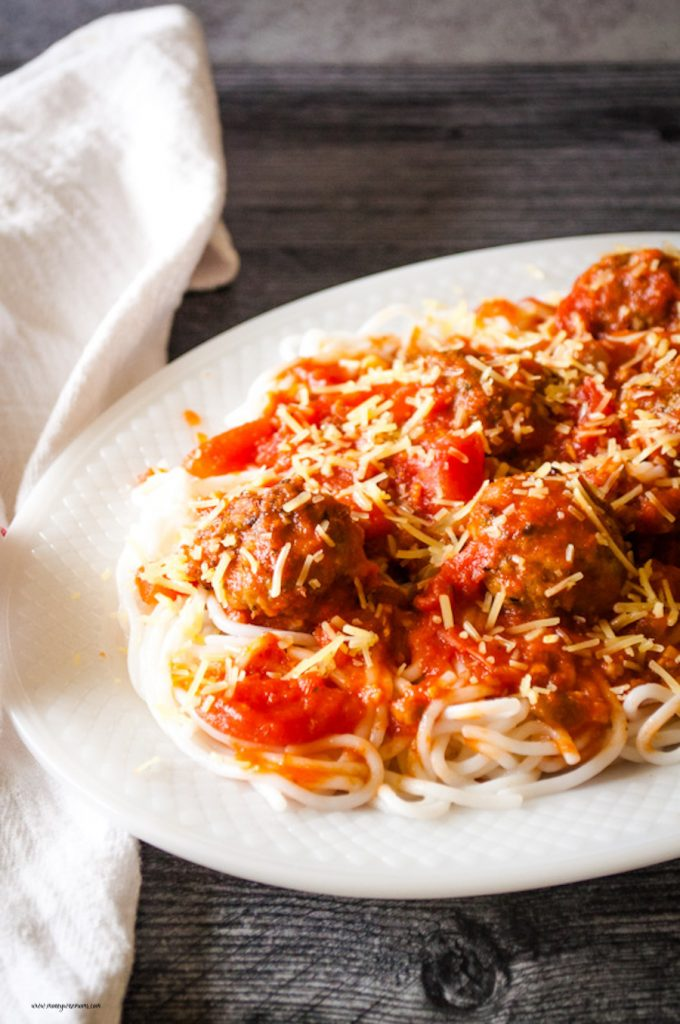 A platter of the finished meatballs with spaghetti ready to eat.