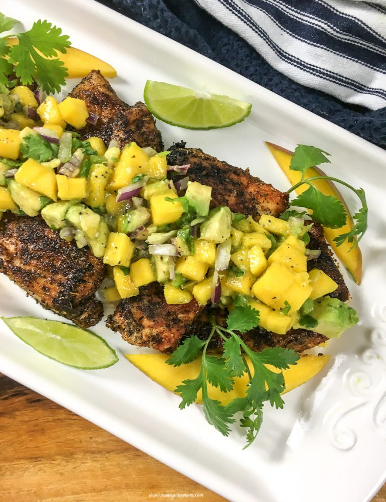 This easy homemade salsa is delicious, perfect for a snack with chips, topping chicken, fish, or even pork! Try out this zesty mango avocado salsa today!
