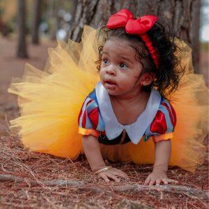 Baby Girl in Tutu Dress Crawling Near Tree