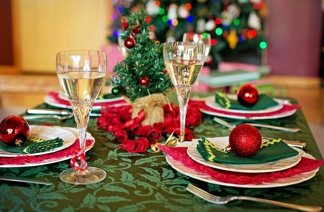 Christmas table decorated with tablecloth plates and napkins - How to Save Money Now for Holiday Shopping