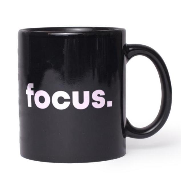 Black coffee mug with word focus