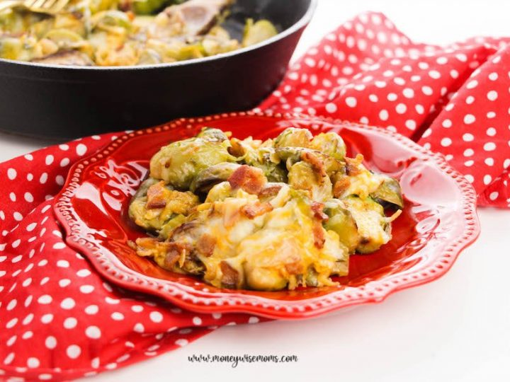 Featured image showing the finished baked brussels sprouts on a plate ready to eat.