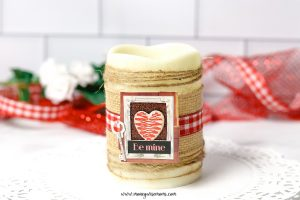 Featured image showing the finished dollar tree valentine candle craft.