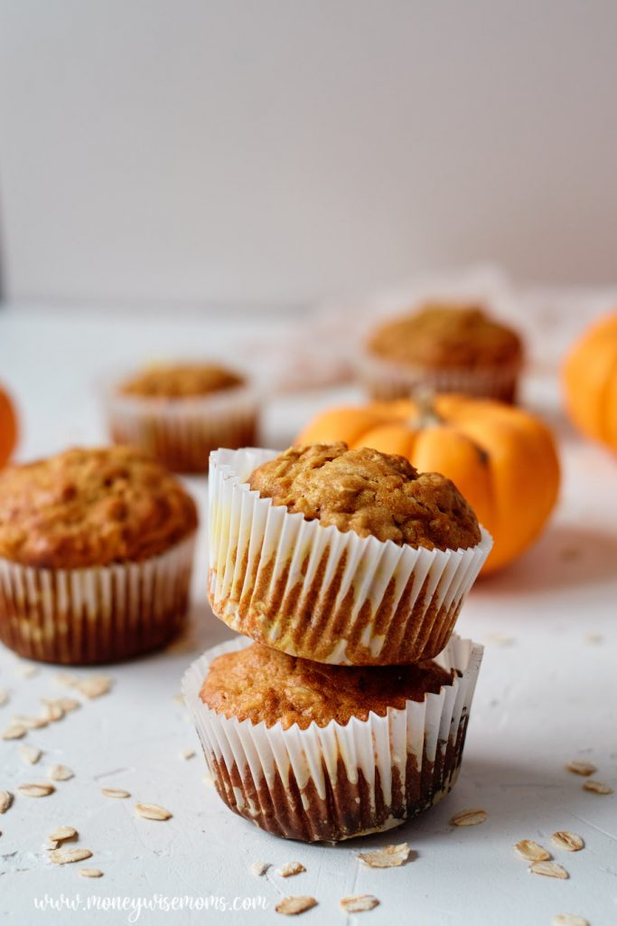Pumpkin muffins with oatmeal stacked up ready to serve.
