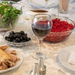 Thanksgiving table with side dishes turkey and wine