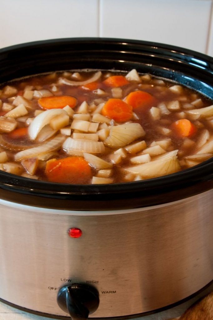 Onions and carrots in crockpot meal planning
