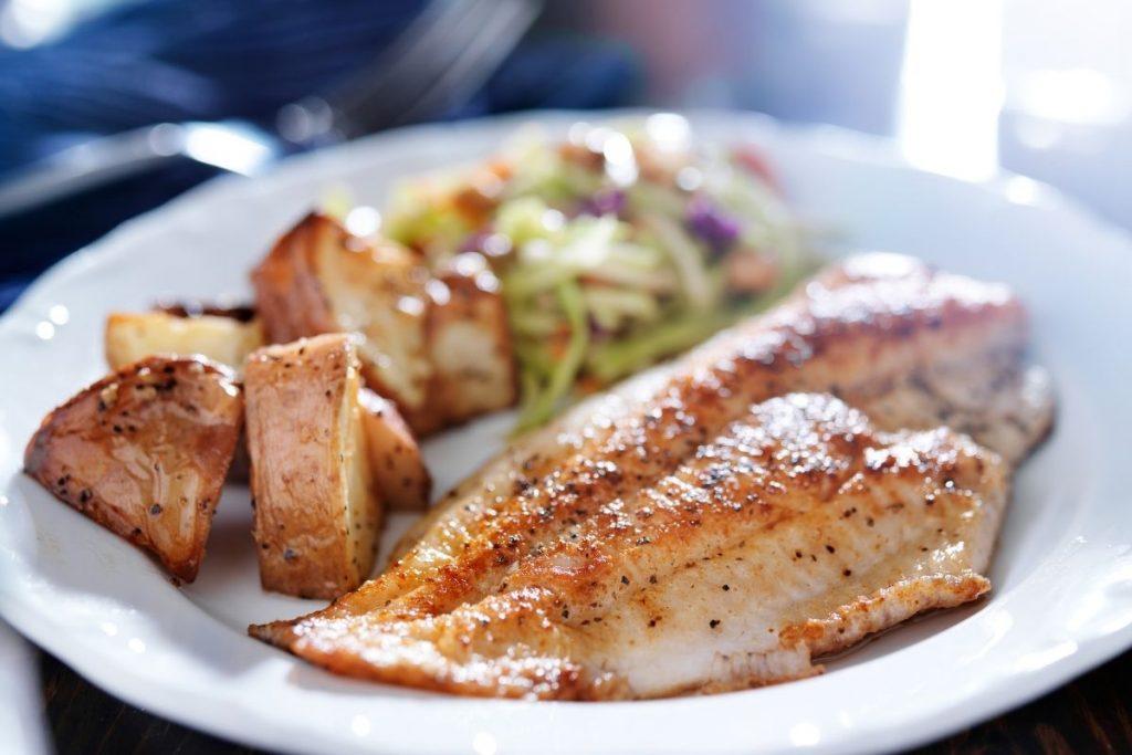 tilapia and potatoes on white plate - easy tilapia recipes