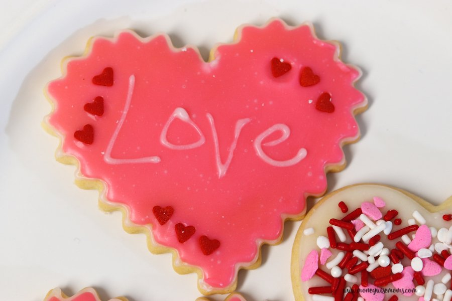 here we see a valentine heart cookie with the word love written on it.