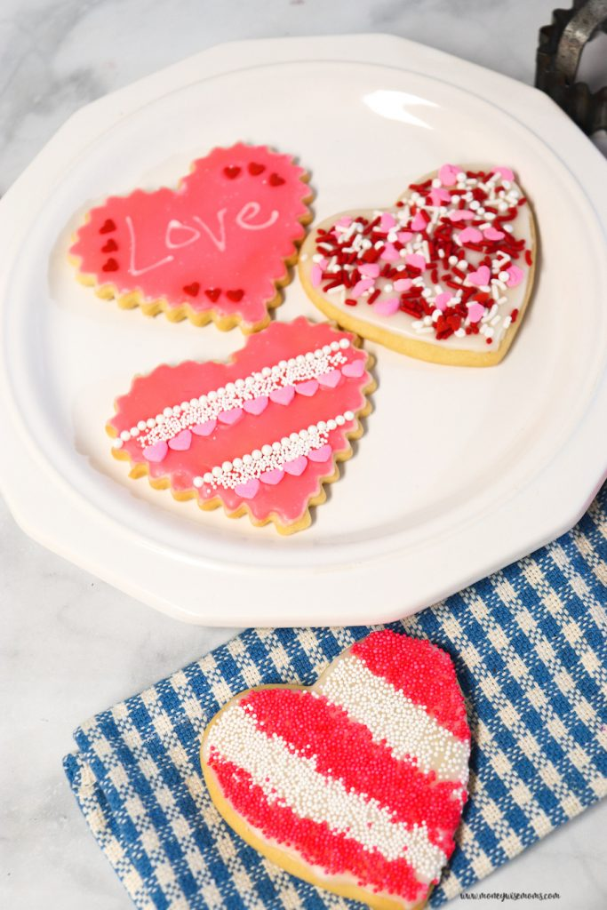 A variety of cookies each decorated differently for valentine's day.