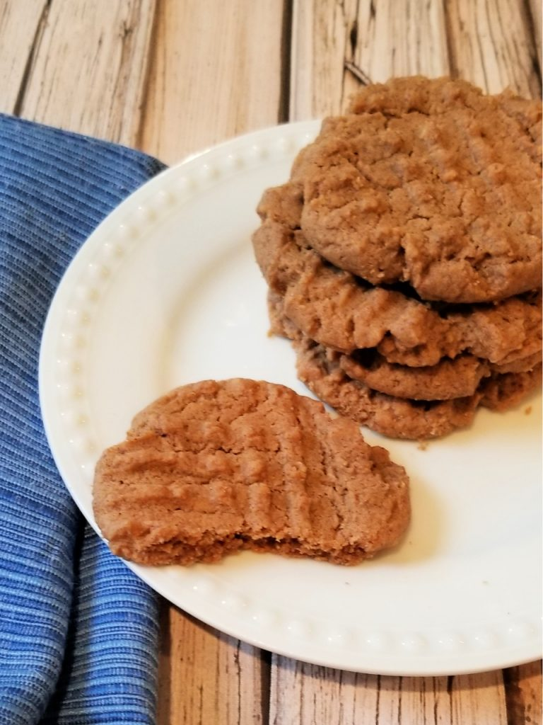 A plate full of the finished almond butter cookies ready to eat or share.
