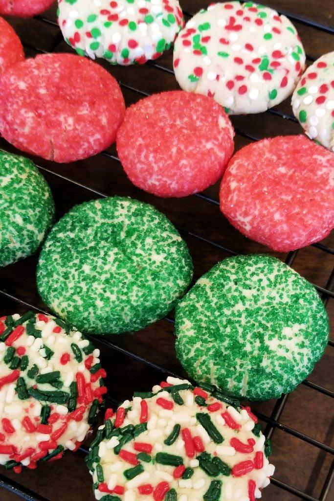Assorted sugar cookies on cooling rack