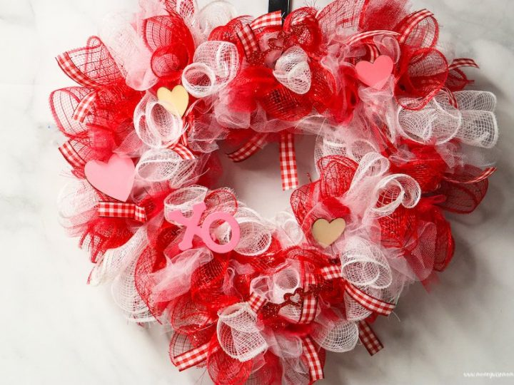 Featured image showing the finished dollar tree valentine wreath ready to hang up or share!