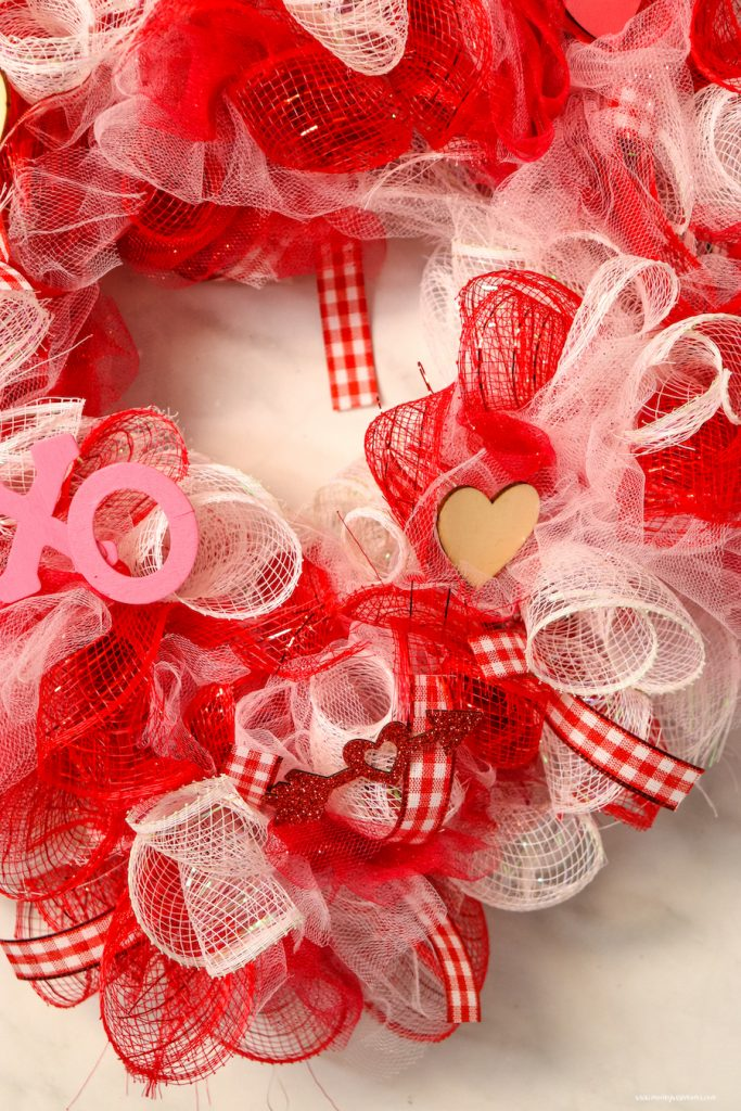 A great look at the finished valentine's day wreath ready to hang up!