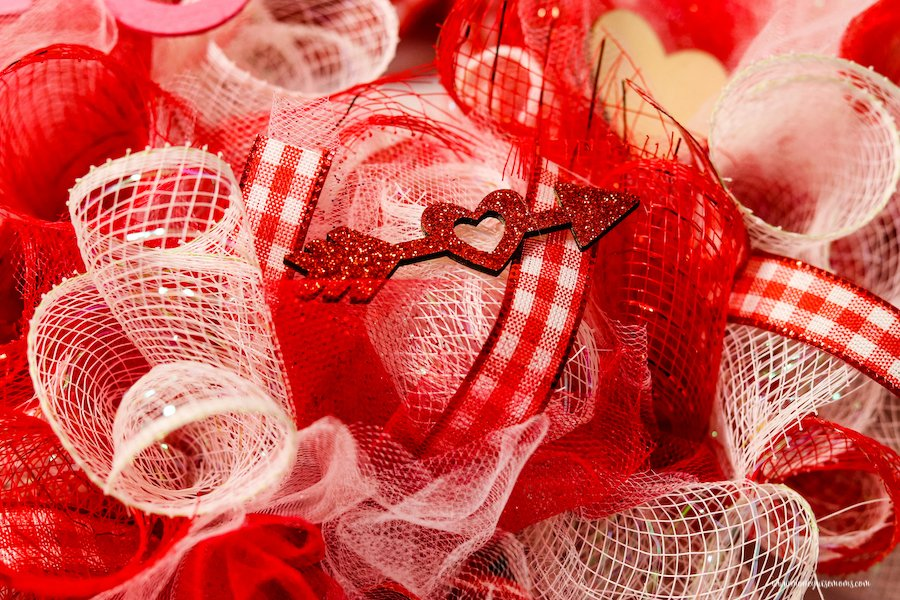 A close up of the valentine deco mesh wreath ready to hang.