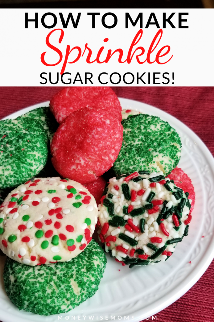 Red and Green sugar cookies with sprinkles on white plate on red placemat