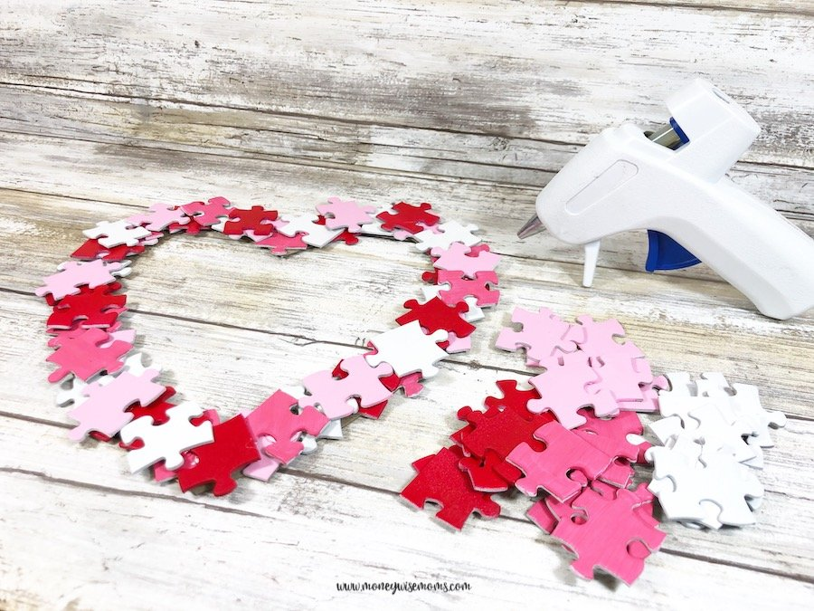 Upcycle a puzzle with missing pieces into a cute Valentine's Heart Wreath and let your family know that you love them to pieces! What a frugal way to decorate for the holiday.