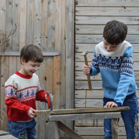Two boys with tools and wood