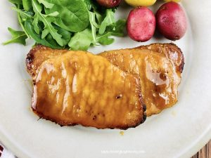 Featured image showing the finished easy baked pork chops recipe.