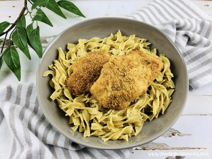 finished parmesan crusted chicken with buttered noodles.