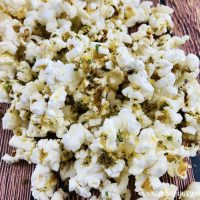 Featured image showing the finished zesty ranch popcorn ready to eat.