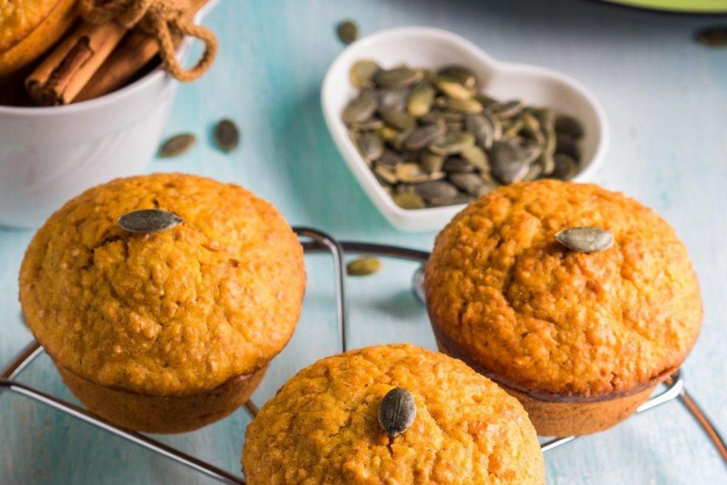 pumpkin wheat muffins on silver circular cooling rack