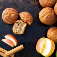 cinnamon maple muffins with cinnamon stick and apple slices