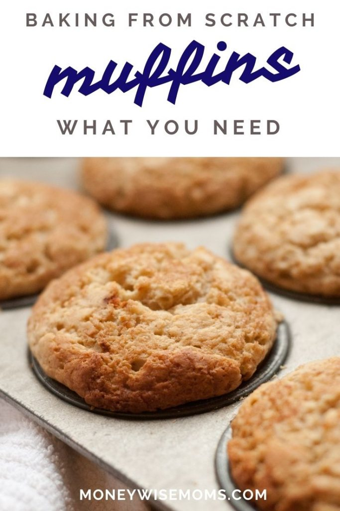muffins in metal tin with white dishtowel